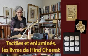 Hind Cherrat debout derrière son bureau dans son atelier. Elle travaille.